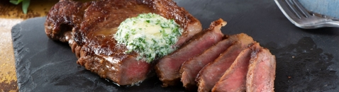 Sous Vide Strip Loin Steak with Herbed Goat Cheese Butter