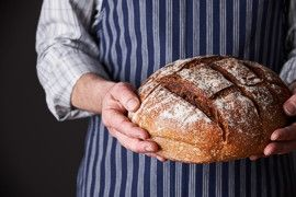 Baker with artisan boule