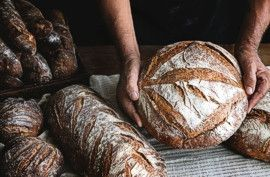 Baker with artisan breads